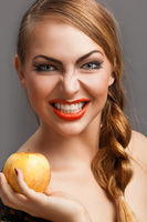 Young beautiful woman with an apple
