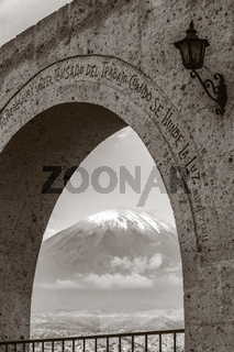 Monochromatic view of volcano Misti in Arequipa Peru framed by arch in Yanahuara square
