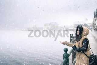 Woman enjoying the first snowfall