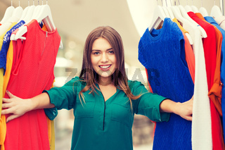 happy woman choosing clothes at home wardrobe