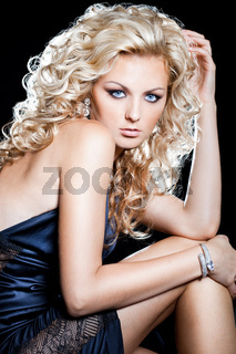 beautiful fashionable woman on black background