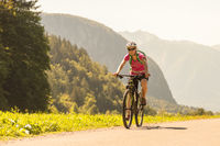 Active sporty woman riding mountain bike in nature.