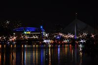 Pleasant bay and Zakim Bridge in the distance at night, Boston, Massachusetts, USA