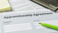 An Apprenticeship agreement with a pen on a desk