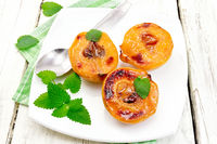 Quince baked with mint in plate on board