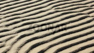 Strukturen im Sand des Wattenmeers