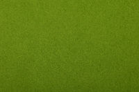 Green felt background texture close up