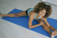 Cheerful woman posing while stretching