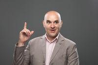 Bald guy having a good idea. Expressive portrait.
