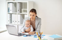 businesswoman with baby working at office