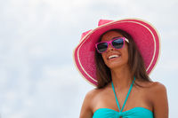 Smiling woman in sunhat