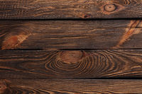 Texture of boards of dark old brown wood