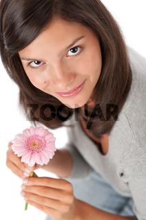 Teenager holding gerbera daisy