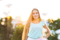 Outdoors portrait of beautiful young blond woman
