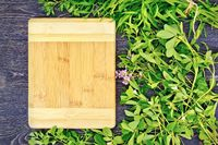 Frame of spicy grass and rectangular board