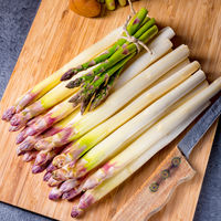 white and green asparagus on kitchen board