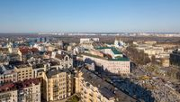 view on the modern buildings in the city center, St. Andrew's Church, Podolsky Bridge and the left coast of the city Kiev, Ukraine