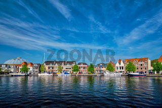 Boats and houses on Spaarne river. Haarlem, Netherlands