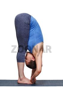 Woman doing Ashtanga Vinyasa yoga asana Padangusthasana - foot t