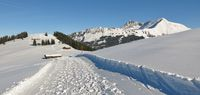 Winter hiking trail on top of mount Hohe Wispile. Winter landscape near Gstaad.