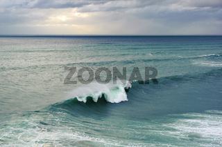 Huge ocean wave breaking in Nazare, Portugal