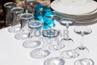 many clean glasses upside down on table