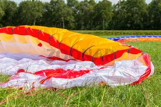 Parachute lying in green grass