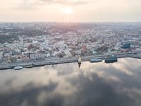 View of the Dnieper river, church of St. Nicholas on the water, River station and Naberezhno-Kreschatitska street on the sunset in Kiev, Ukraine.