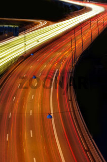 cars at night with motion blur