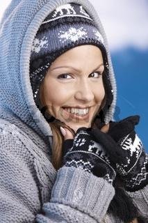 Pretty skier enjoying winter smiling