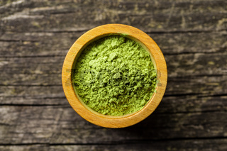 Green matcha tea powder.