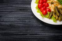 Pickled Vegetables on rustic wooden background
