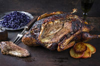 Roast Goose with Orange Slices and Blue Kraut on old Metal Sheet