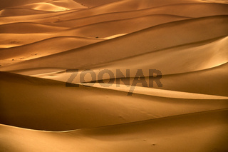 Background with sandy dunes in desert