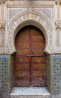 Traditional entrance gate with door in Fes