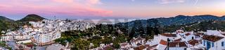Wide stitched panorama of Frigiliana at twilight,Spain