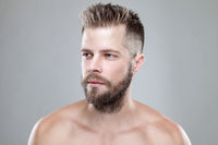 Portrait of young handsome bearded man with a new hair cut