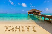 Word Tahiti on beach