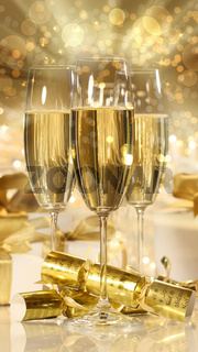 Glasses of champagne and gifts for new years
