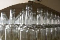 Empty glass bottles. Whiskey and brandy distillery