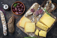 Traditional French cold cuts with Cheese and Salami as top view on old cutting board
