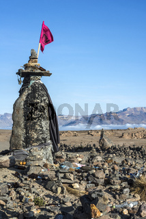 A stone witch stands by the road to the valley of the Colca River Canyon, Peru