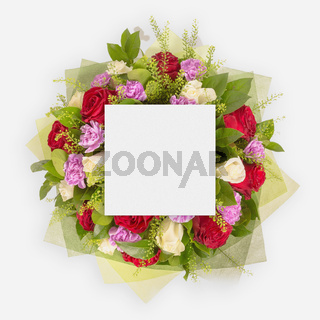 Creative layout made of flowers and leaves with paper card note. Flat lay