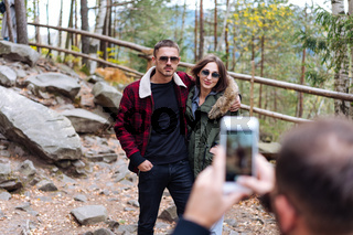 guy and girl are posing on camera