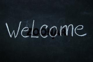 Word written in chalk on blackboard