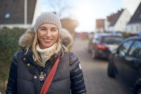 Smiling happy woman outdoors on a cold winter day