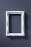 Empty picture frame on dark background