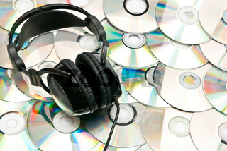 CDs background with headphones