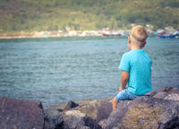 Cute caucasian boy at seaside