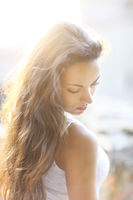 Young beautiful natural brunette woman at summer sunset, portrait. Happiness fun and harmony concept